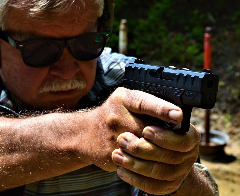 Bob Campbell shooting the Beretta APX Carry pistol while wearing safety glasses